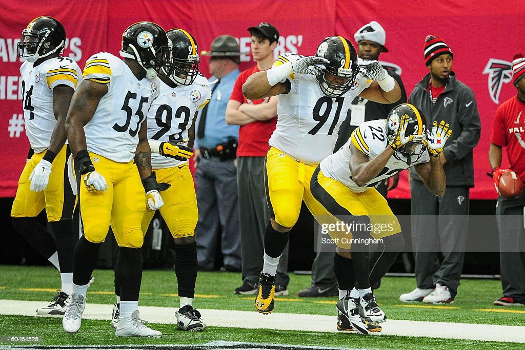 <a gi-track='captionPersonalityLinkClicked' href=/galleries/search?phrase=William+Gay&family=editorial&specificpeople=2108843 ng-click='$event.stopPropagation()'>William Gay</a> #22 of the Pittsburgh Steelers celebrates an interception and touchdown with <a gi-track='captionPersonalityLinkClicked' href=/galleries/search?phrase=Stephon+Tuitt&family=editorial&specificpeople=8563449 ng-click='$event.stopPropagation()'>Stephon Tuitt</a> #91 in the first half against the Atlanta Falcons at the Georgia Dome on December 14, 2014 in Atlanta, Georgia.