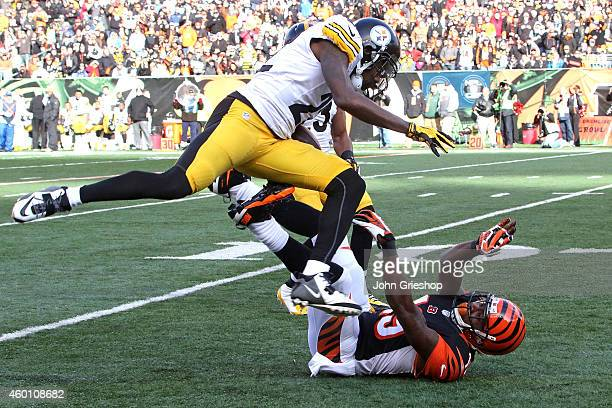 William Gay of the Pittsburgh Steelers jumps over Brandon Tate of the Cincinnati Bengals after intercepting a pass during the second quarter at Paul...