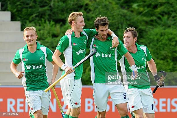 William Geoffrey McCabe of Ireland celebrates with team mates after scoring his team's second goal during the Men´s EuroHockey Championships 2011...