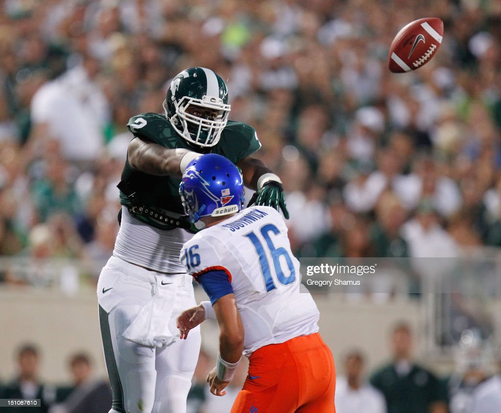 William Gholston #2 of the Michigan State Spartans bats down a first-quarter pass by Joe Southwick #16 of the Boise State Broncos at Spartan Stadium on August, 2010 in East Lansing, Michigan.