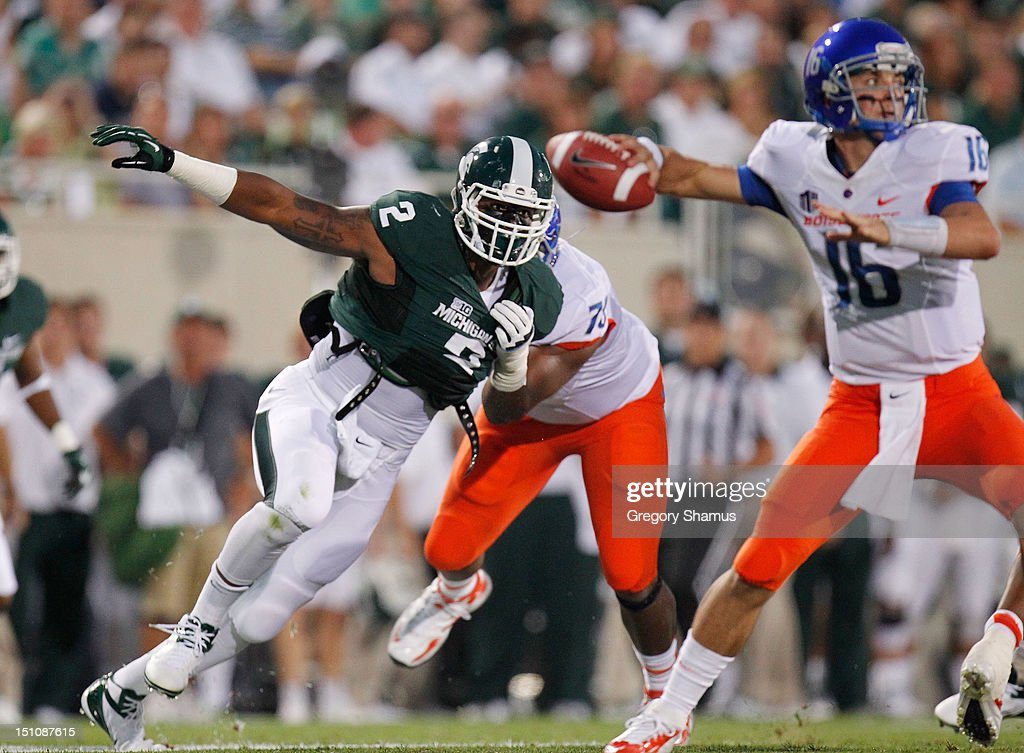 William Gholston #2 of the Michigan State Spartans gets around the block of Faraji Wright #75 of the Boise State Broncos on his way to quarterback Joe Southwick #16 at Spartan Stadium on August, 2010 in East Lansing, Michigan.