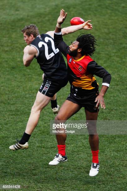 William GREGSON of New Zealand and John Ikupu of Papua New Guinea during the 2017 AFL International Cup Grand FInal match between New Zealand and...