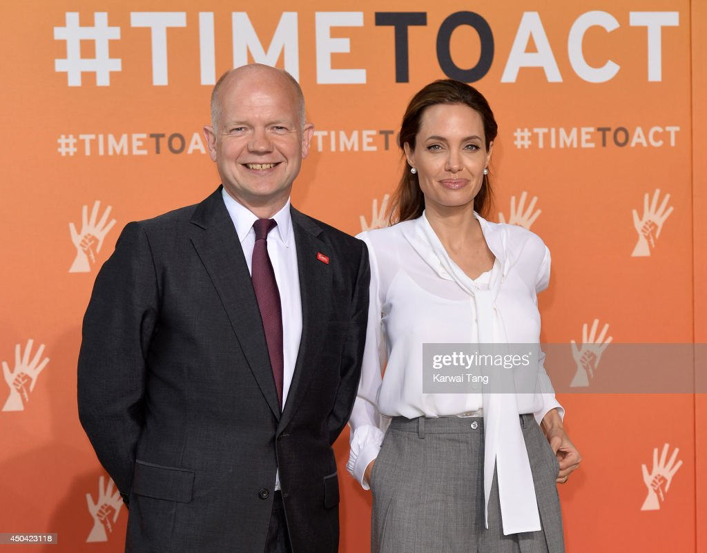 <a gi-track='captionPersonalityLinkClicked' href=/galleries/search?phrase=William+Hague&family=editorial&specificpeople=206295 ng-click='$event.stopPropagation()'>William Hague</a> and <a gi-track='captionPersonalityLinkClicked' href=/galleries/search?phrase=Angelina+Jolie&family=editorial&specificpeople=201591 ng-click='$event.stopPropagation()'>Angelina Jolie</a> attend the Global Summit to end Sexual Violence in Conflict at ExCel on June 11, 2014 in London, England.
