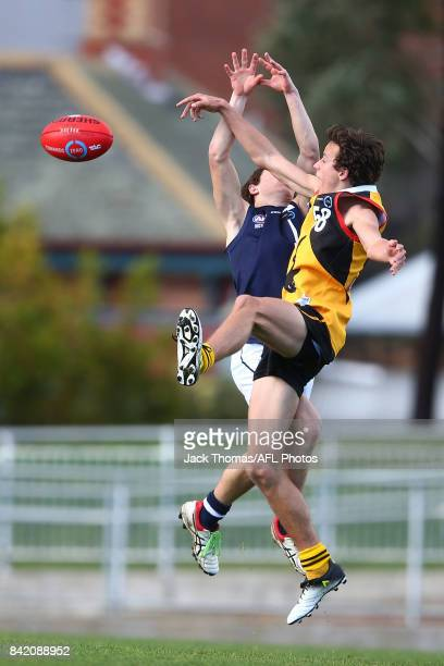 William Hamill of the Dandenong Stingrays and Lachlan Noble of the Geelong Falcons compete for the ball during the TAC Cup round 18 match between...
