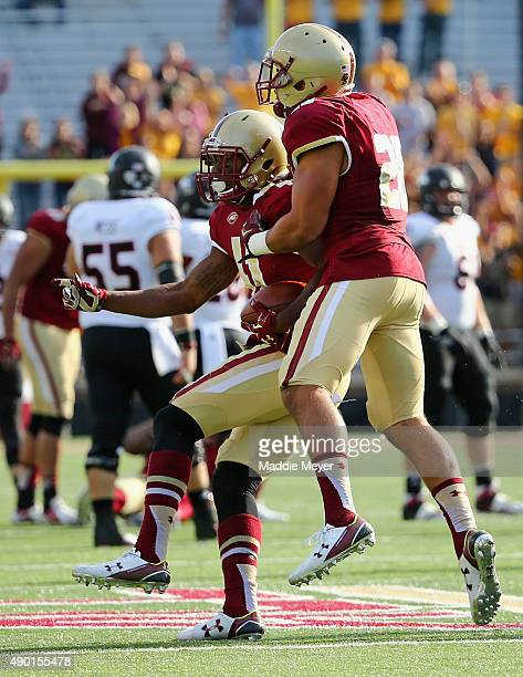 William Harris of the Boston College Eagles celebrates his interception against Northern Illinois Huskies with Matt Milano at Alumni Stadium on...