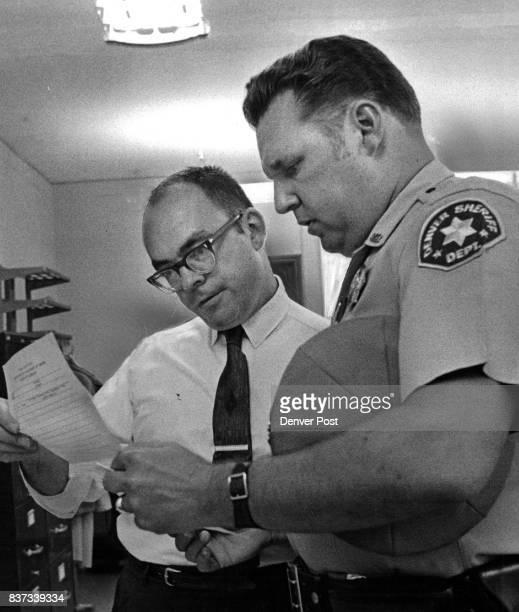 William Hight left is Handed a Citation Denver Sheriff's Deputy B J Peacock serves the papers Credit Denver Post