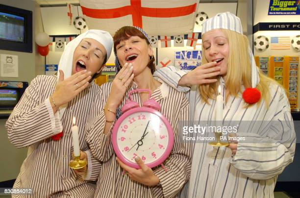 William Hill betting shop staff open up in their nightclothes at 700am in London in readiness for England's early kick off against Nigeria at 730am...