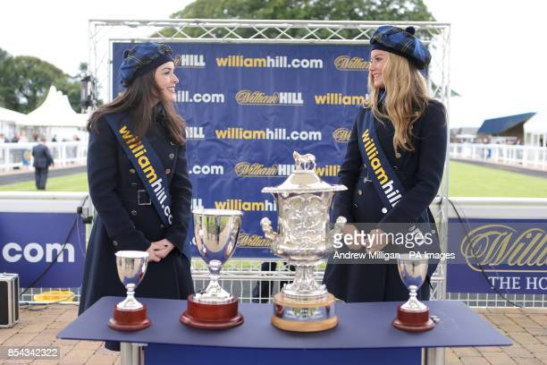 William Hill promotional staff stand with the day's cups