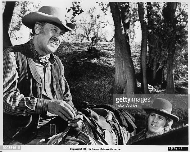 William Holden and Ryan O'Neal ride in a scene for the the MGM movie 'Wild Rovers' circa 1971