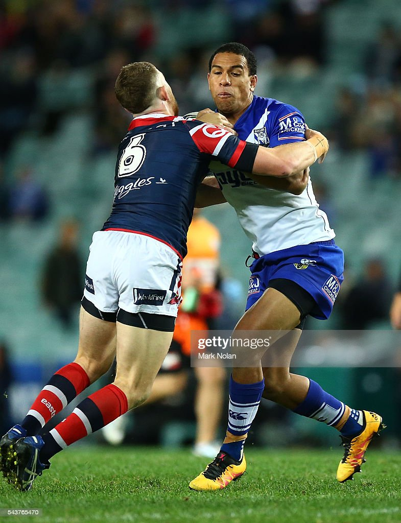 William Hopoate of the Bulldogs is tackled during the round 17 NRL match between the Sydney Roosters and the Canterbury Bulldogs at Allianz Stadium on June 30, 2016 in Sydney, Australia.