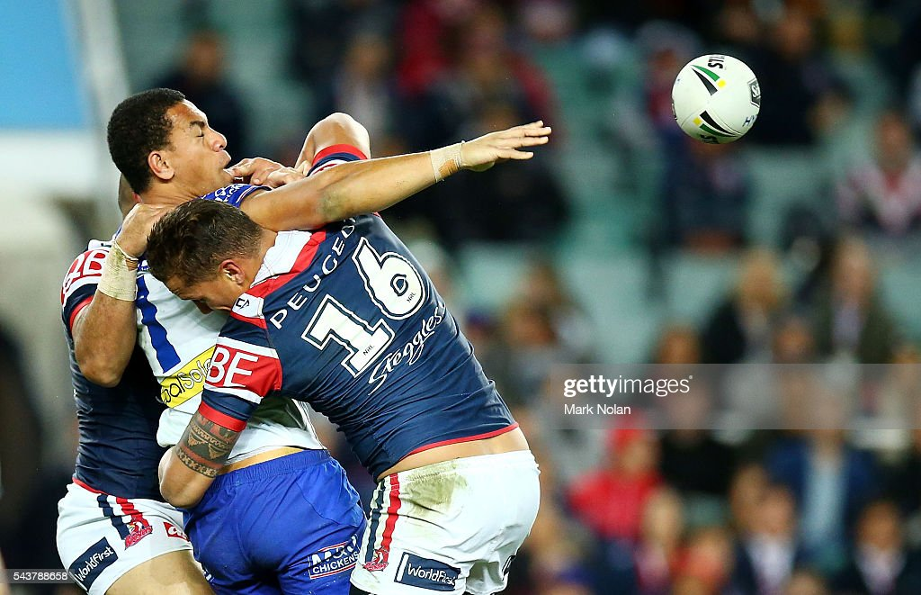 William Hopoate of the Bulldogs offloads during the round 17 NRL match between the Sydney Roosters and the Canterbury Bulldogs at Allianz Stadium on June 30, 2016 in Sydney, Australia.