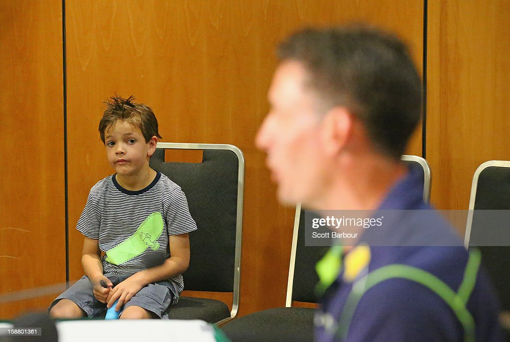 William Hussey, the son of <a gi-track='captionPersonalityLinkClicked' href=/galleries/search?phrase=Michael+Hussey&family=editorial&specificpeople=171690 ng-click='$event.stopPropagation()'>Michael Hussey</a> of Australia watches his dad during at a press conference on December 30, 2012 in Melbourne, Australia. Mike Hussey has announced that the third Vodafone Test against Sri Lanka in Sydney will be his last Test for Australia.