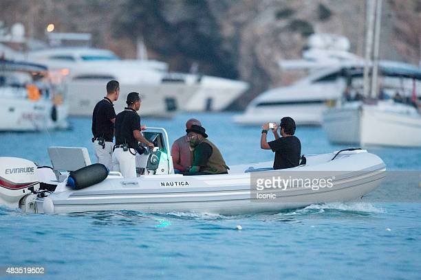 william is seen leaving a beach club in a boat on August 9 2015 in Ibiza Spain