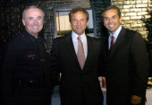 William J Bratton Los Angeles Police Chief Jim Wiatt CEO of William Morris Agency and Los Angeles Mayor Antonio Villaraigosa