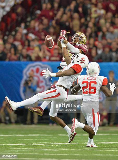 William Jackson III and Brandon Wilson of the Houston Cougars break up a pass intended for Travis Rudolph of the Florida State Seminoles in the third...