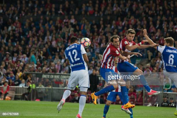 William Jose head to goal meanwhile Godin and Saul try to block during the match between Atletico de Madrid and Real Sociedad AtMadrid won over Real...