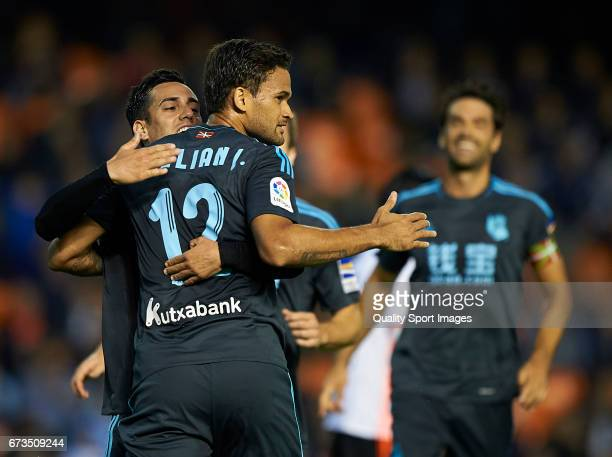William Jose of Real Sociedad celebrates with his teammates after scoring the second goal during the La Liga match between Valencia CF and Real...