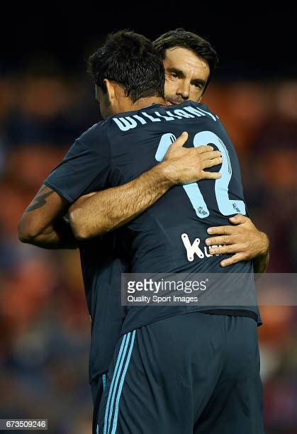 William Jose of Real Sociedad celebrates with Inigo Martinez of Real Sociedad after scoring the second goal during the La Liga match between Valencia...