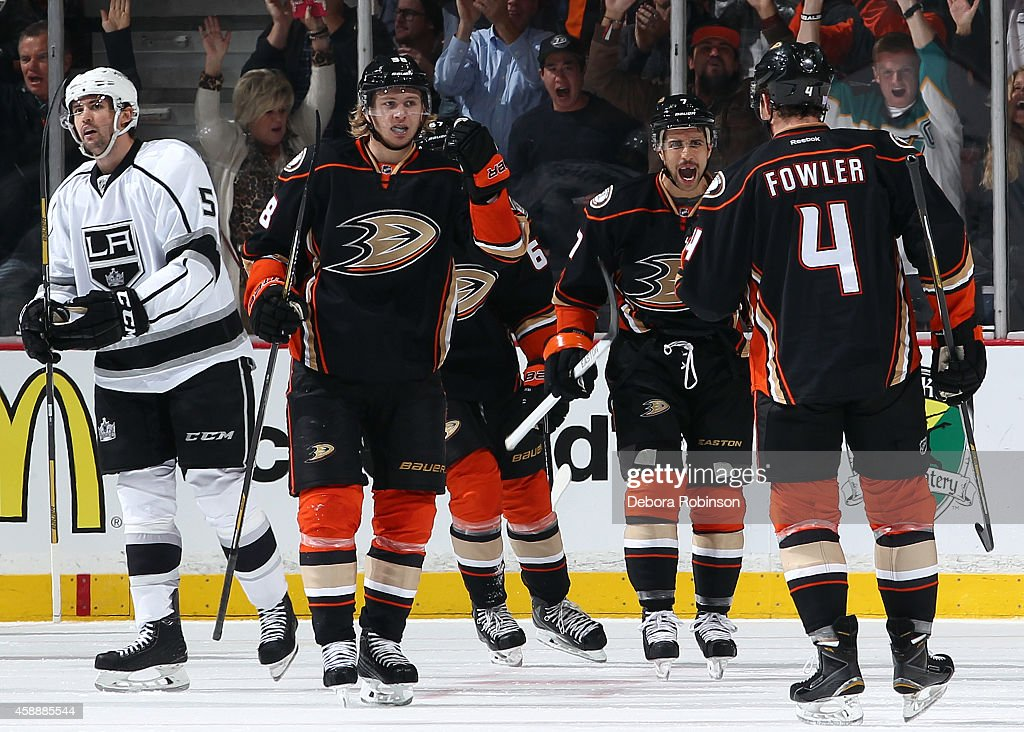 William Karlsson and Andrew Cogliano of the Anaheim Ducks celebrate a goal by Cam Fowler as Jamie McBain of the Los Angeles Kings skates away on...