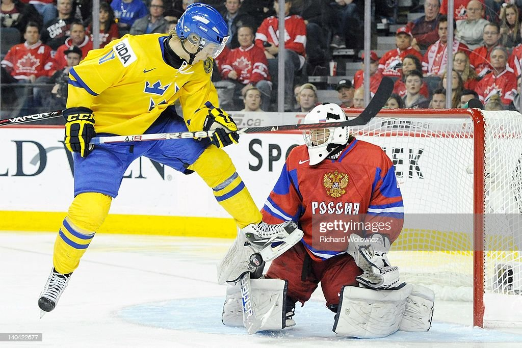 William Karlsson #17 of Team Sweden deflects the puck in front of Andrei Makarov #20 of Team Russia during the 2012 World Junior Hockey Championship Gold Medal game at the Scotiabank Saddledome on January 5, 2012 in Calgary, Alberta, Canada. Team Sweden defeated Team Russia 1-0 in overtime.