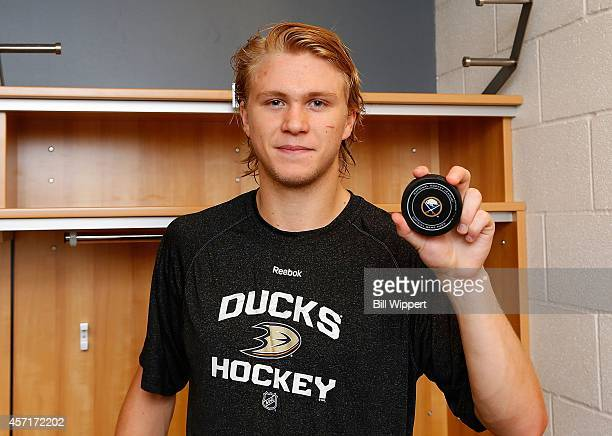 William Karlsson of the Anaheim Ducks holds the puck he used to score his first career NHL goal against the Buffalo Sabres on October 13 2014 at the...