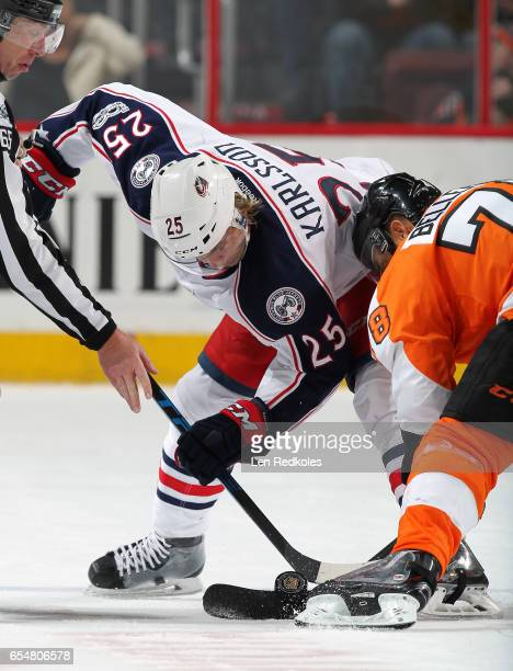 William Karlsson of the Columbus Blue Jackets battles for the puck on a faceoff against PierreEdouard Bellemare of the Philadelphia Flyers on March...
