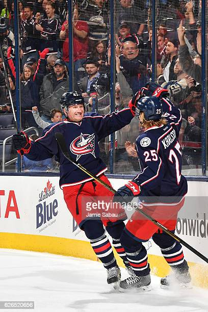 William Karlsson of the Columbus Blue Jackets celebrates his first period goal with teammate Scott Hartnell of the Columbus Blue Jackets during a...