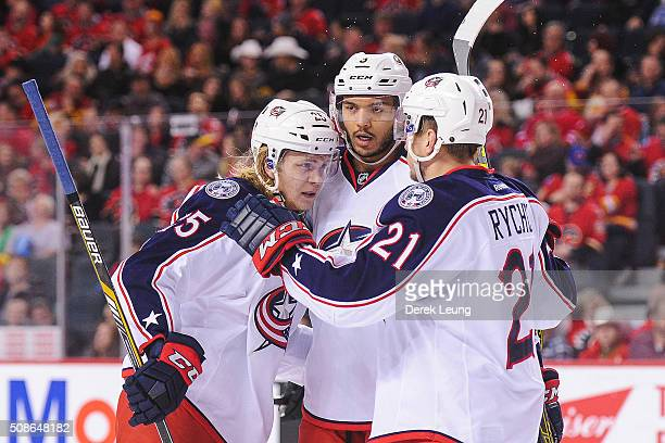 William Karlsson of the Columbus Blue Jackets celebrates with his teammates after scoring against the Calgary Flames during an NHL game at Scotiabank...