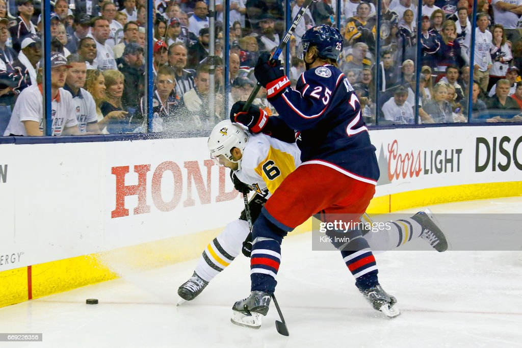 William Karlsson #25 of the Columbus Blue Jackets checks Trevor Daley #6 of the Pittsburgh Penguins while chasing after the puck during overtime in Game Three of the Eastern Conference First Round during the 2017 NHL Stanley Cup Playoffs on April 16, 2017 at Nationwide Arena in Columbus, Ohio. Pittsburgh defeated Columbus 5-4 in overtime. Pittsburgh leads the series 3-0.