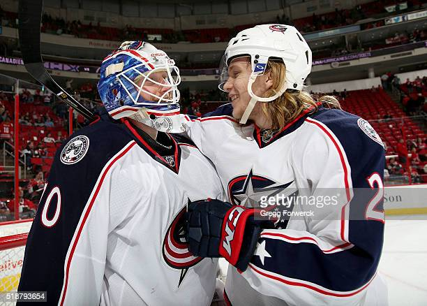 William Karlsson of the Columbus Blue Jackets congratulates Joonas Korpisalo on his win against the Carolina Hurricanes following an NHL game at PNC...