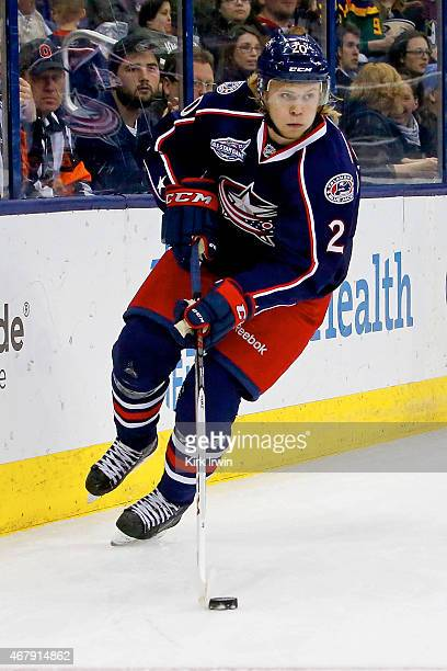 William Karlsson of the Columbus Blue Jackets controls the puck during the game against the Anaheim Ducks on March 24 2015 at Nationwide Arena in...