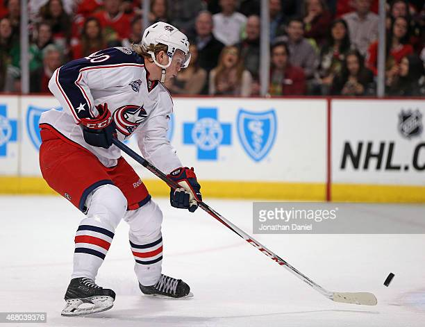 William Karlsson of the Columbus Blue Jackets gets off a shot against the Chicago Blackhawks at the United Center on March 27 2015 in Chicago...
