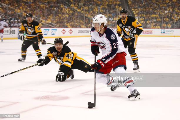 William Karlsson of the Columbus Blue Jackets looks to get a shot off past Conor Sheary of the Pittsburgh Penguins during the first period in Game...