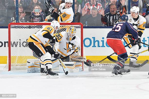 William Karlsson of the Columbus Blue Jackets scores on goaltender Matthew Murray of the Pittsburgh Penguins during the second period of a game on...