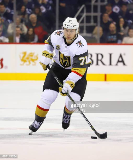 William Karlsson of the Vegas Golden Knights plays the puck down the ice during third period action against the Winnipeg Jets at the Bell MTS Place...