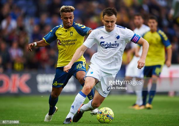 William Kvist of FC Copenhagen and Hany Mukhtar of Brondby IF compete for the ball during the Danish Alka Superliga match between Brondby IF and FC...
