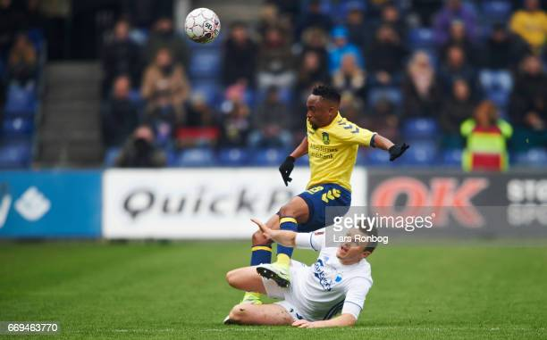 William Kvist of FC Copenhagen and Lebogang Phiri of Brondby IF compete for the ball during the Danish Alka Superliga match between Brondby IF and FC...