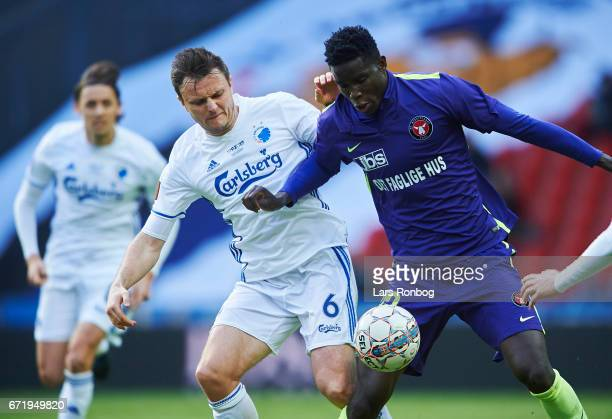 William Kvist of FC Copenhagen and Paul Onuachu of FC Midtjylland compete for the ball during the Danish Alka Superliga match between FC Copenhagen...