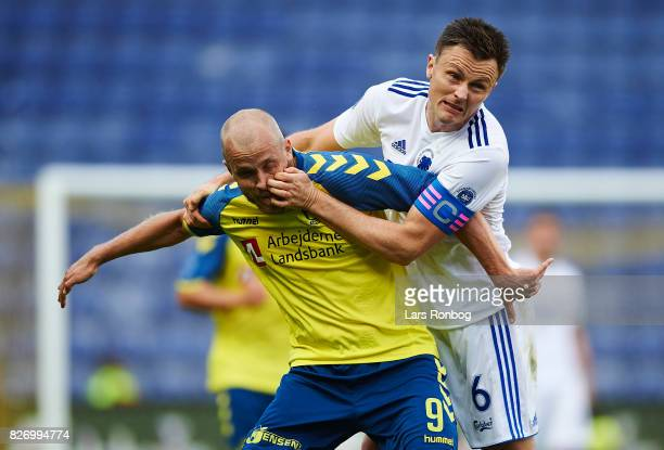 William Kvist of FC Copenhagen and Teemu Pukki of Brondby IF compete for the ball during the Danish Alka Superliga match between Brondby IF and FC...