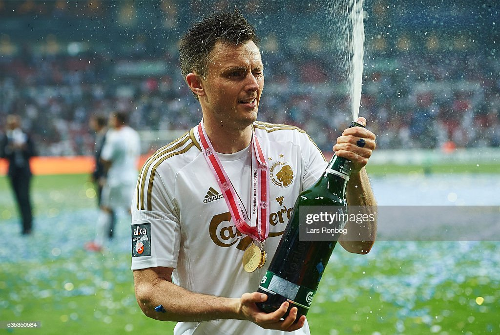 William Kvist of FC Copenhagen celebrates with champagne as Danish Champions 2015/2016 after the Danish Alka Superliga match between FC Copenhagen and AGF Aarhus at Telia Parken Stadium on May 29, 2016 in Copenhagen, Denmark.
