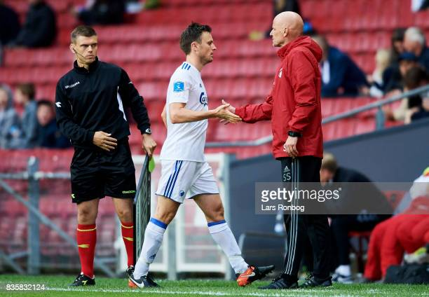 William Kvist of FC Copenhagen shake hands with Stale Solbakken head coach of FC Copenhagen during the Danish Alka Superliga match between FC...