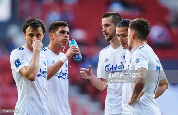 William Kvist of FC Copenhagen speaks to Pieros Sotiriou Michael Luftner Federico Santander and Benjamin Verbic during the Danish Alka Superliga...