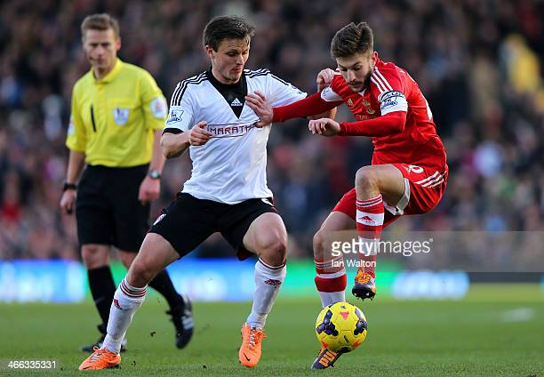 William Kvist of Fulham in action against Adam Lallana of Southampton during the Barclays Premier League match between Fulham and Southampton at...
