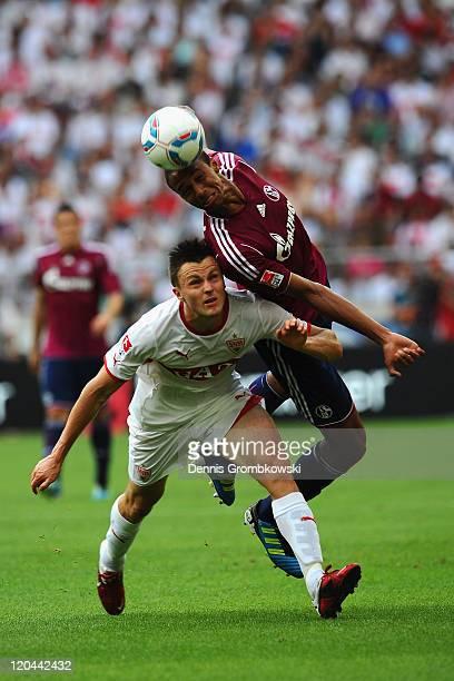 William Kvist of Stuttgart and Joel Matip of Schalke battle for the ball during the Bundesliga match between VfB Stuttgart and FC Schalke 04 at...