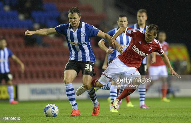 William Kvist of Wigan Athletic is tackled by Robert Tesche of Nottingham Forest during the Sky Bet Championship between Wigan Athletic and...