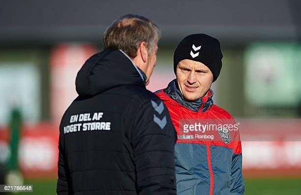 William Kvist speaks to Aga Harried head coach of Denmark prior to the Denmark training session at Gelsingor Stadion on November 8 2016 in Helsingor...