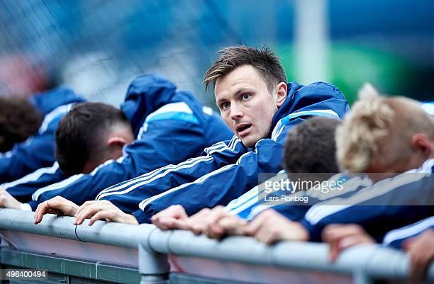 William Kvist stretches out during the Denmark Training Session at Helsingor Stadion on November 9 2015 in Helsingor Denmark