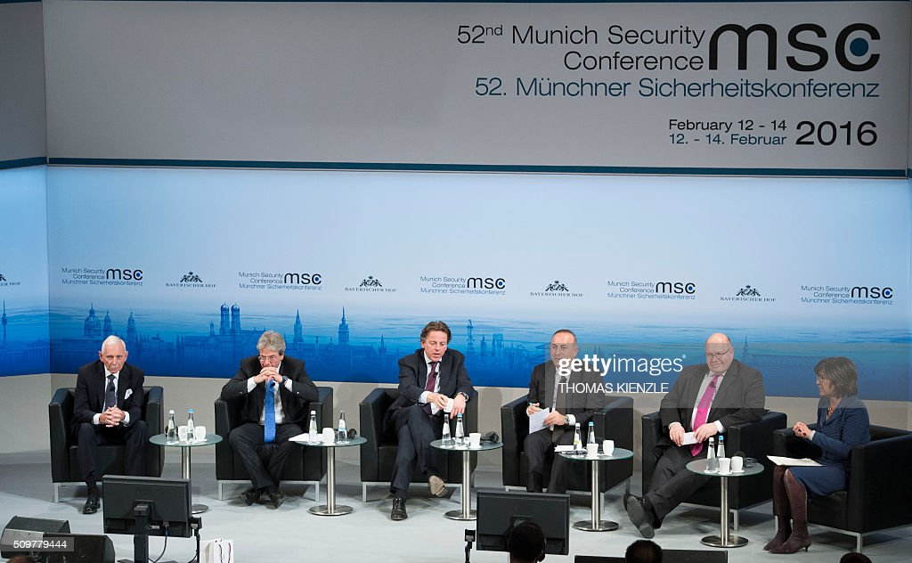 William Lacy Swing, director general of International Organization for Migration, Italian Foreign Minister Paolo Gentiloni, Dutch Foreign Minister Bert Koenders, Foreign Minister of Turkey Mevlut Cavusoglu, Peter Altmeier, German chief of staff at the Chancellery and moderator Christiane Amanpour attend a panel discussion at the 52nd Munich Security Conference (MSC) in Munich, southern Germany, on February 12, 2016 KIENZLE