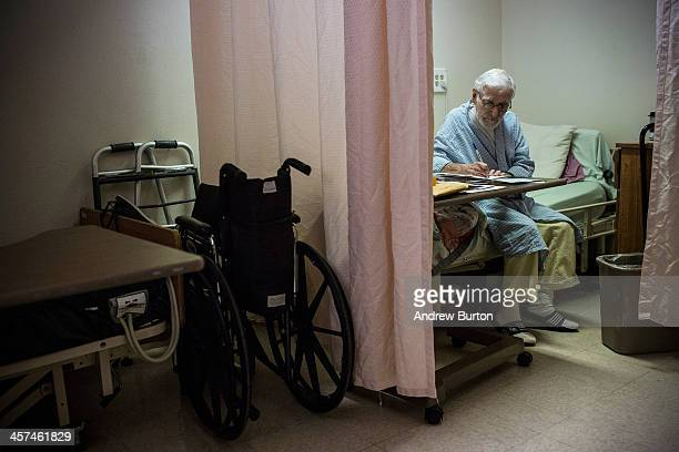 William Lambie a hospice care patient writes his sister a letter in the hospice care wing of California Medical Facility on December 17 2013 in...