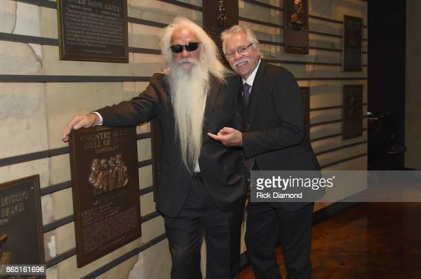 William Lee Golden and Joe Bonsall of The Oak Ridge Boys take photos before the Medallion Ceremony to celebrate 2017 hall of fame inductees Alan...